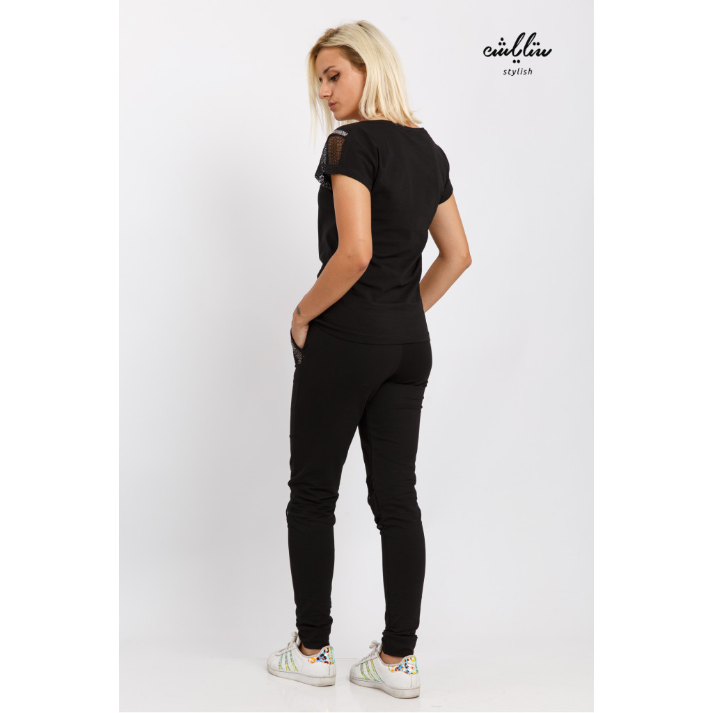 Elegant black sports set decorated with mesh for a stunning look