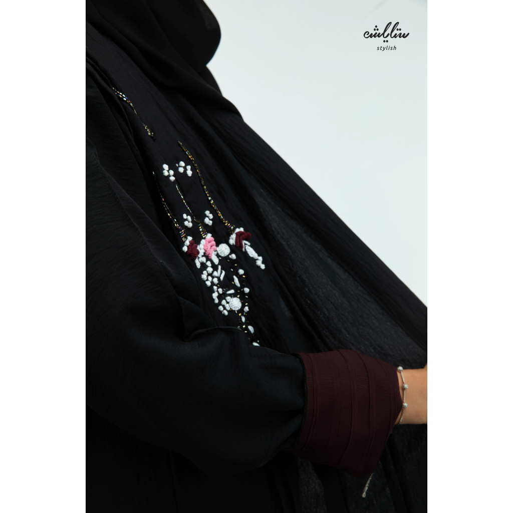 Linen abaya with a wrap model in black color, decorated with embroidery