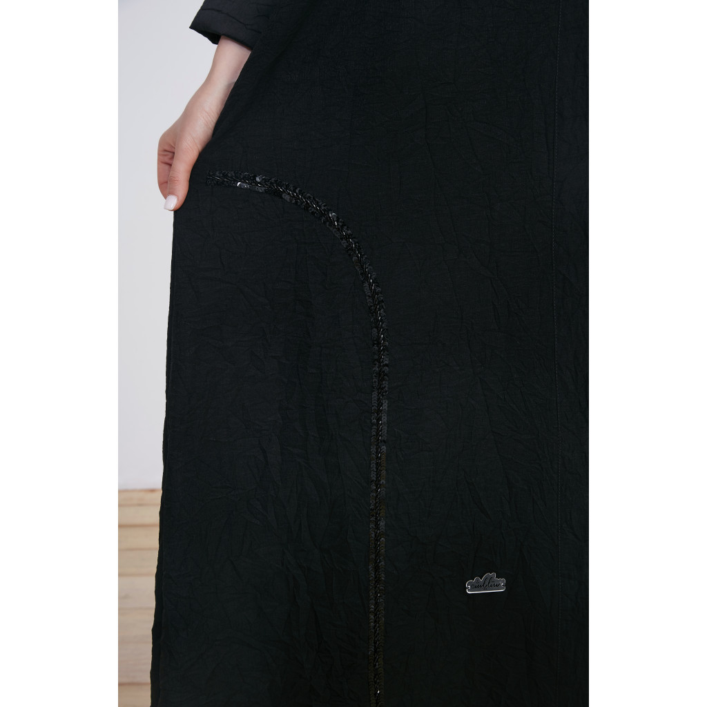 Abaya made of linen fabric decorated with black embroidery