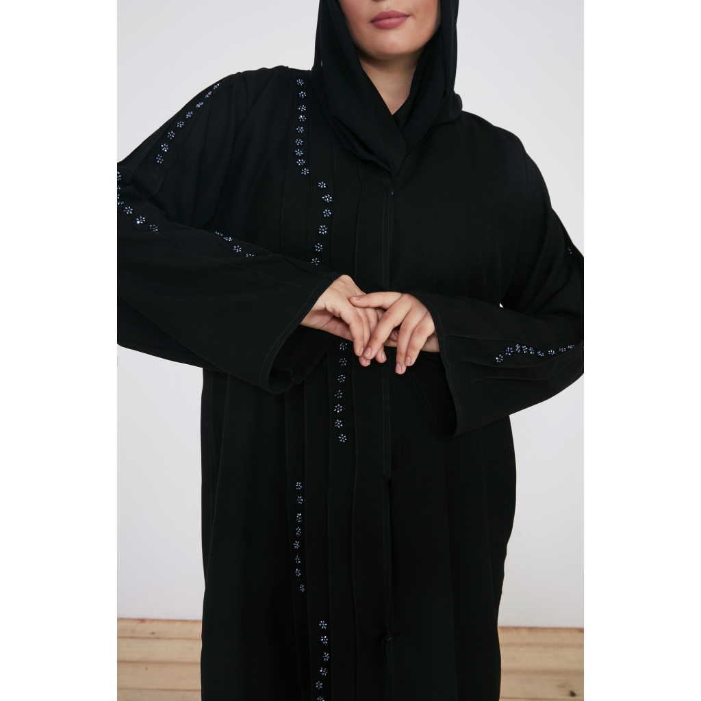 An elegant black abaya with delicate embroidery
