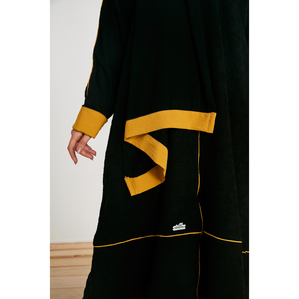 Black abaya decorated with yellow color