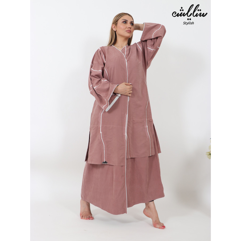Abaya in pink color decorated with white embroidery