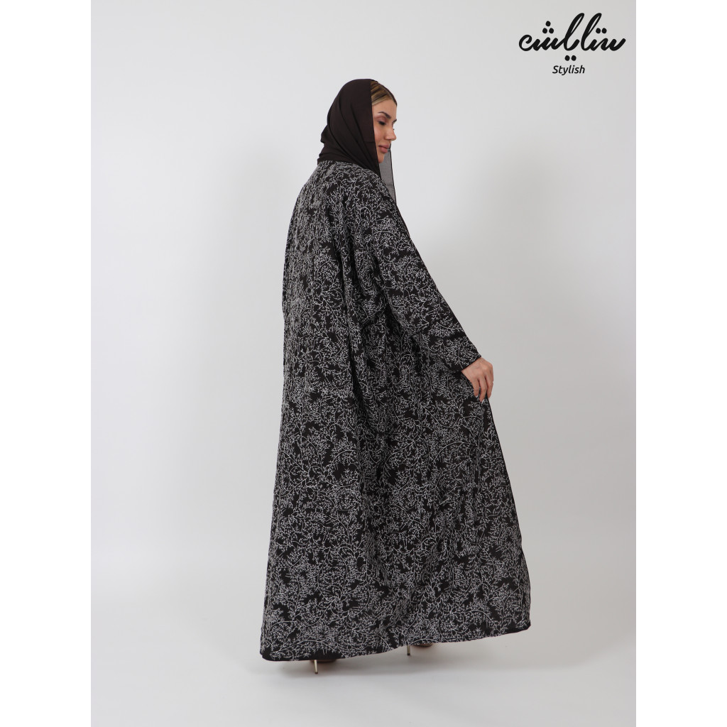 dark brown abaya with white inscriptions