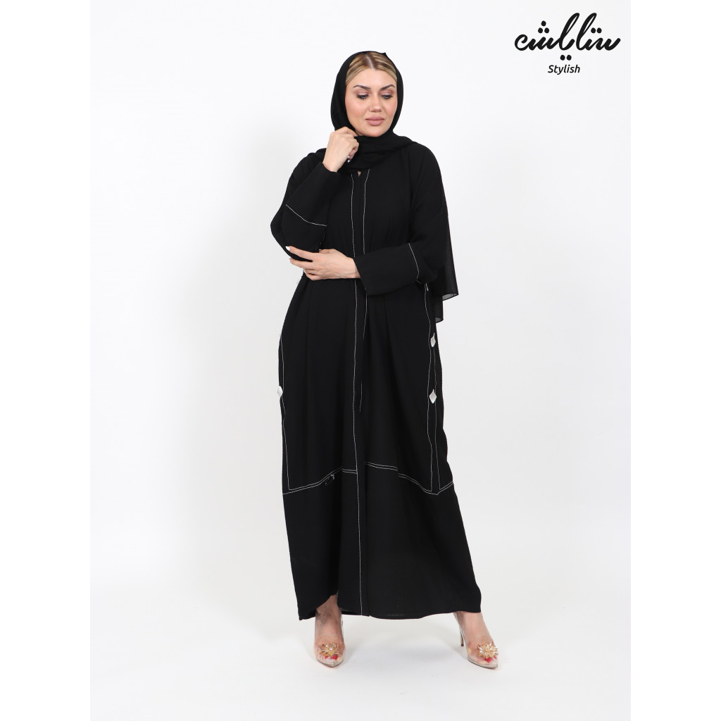 Abaya in black color decorated with strings on the front and on the sleeves