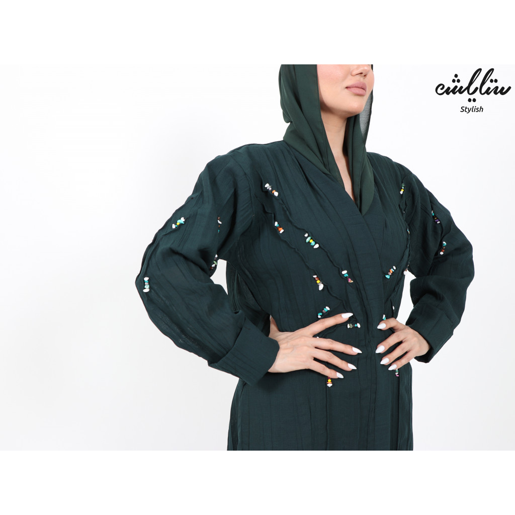 Abaya in oil color decorated with stones