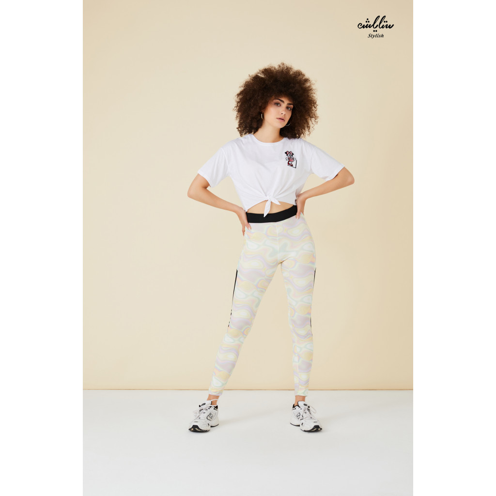 Leggings in light wavy colors with a black side line