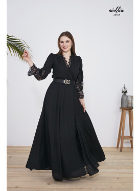 A long black dress embellished with shiny beads and lace on the back and sleeves