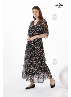 Elegant black dress with floral prints for a charming look.