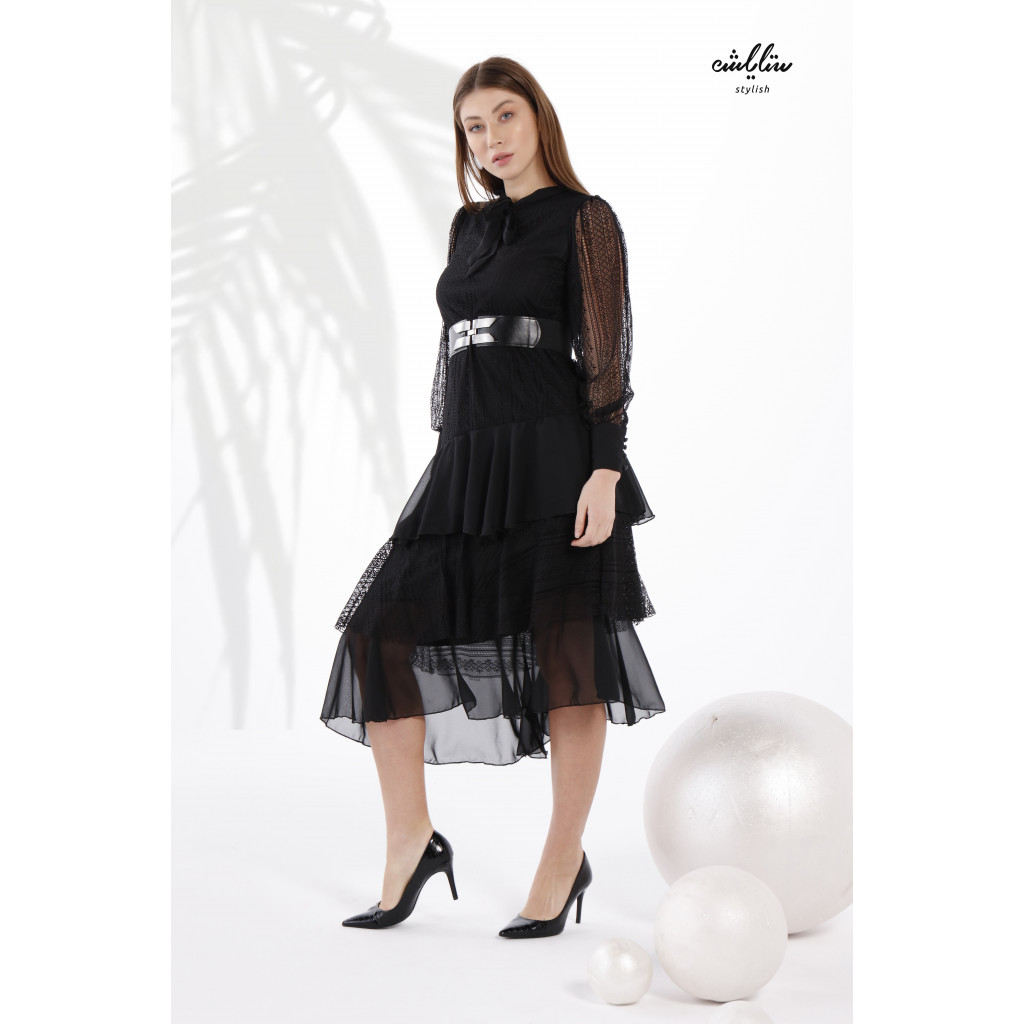 Elegant black dress of a slanting Tiered Layered design and tie for a soft modern look
