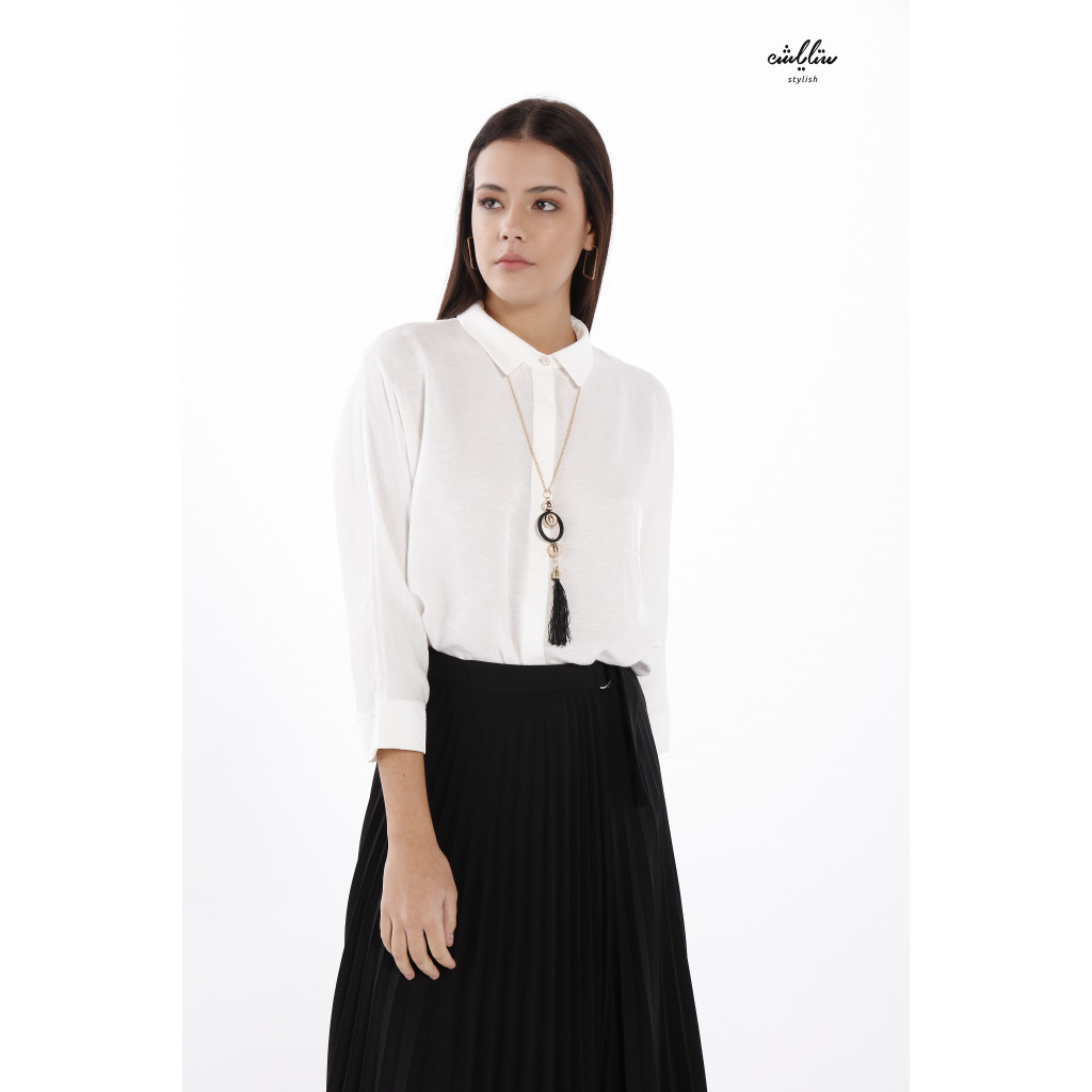 A loose-fitting white blouse and formal collar for a casual look.