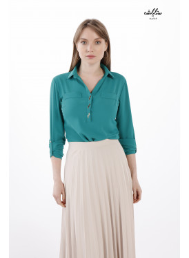 An elegant turquoise blouse with a formal collar decorated with buttons.