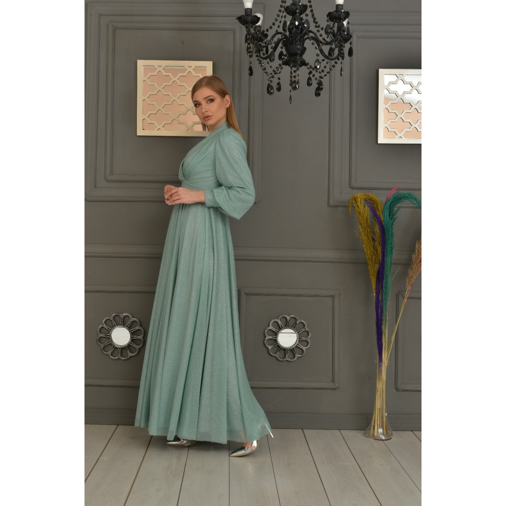 luxurious light green dress in classic style with a long sleeve, and back buttons for a sophisticated and attractive look