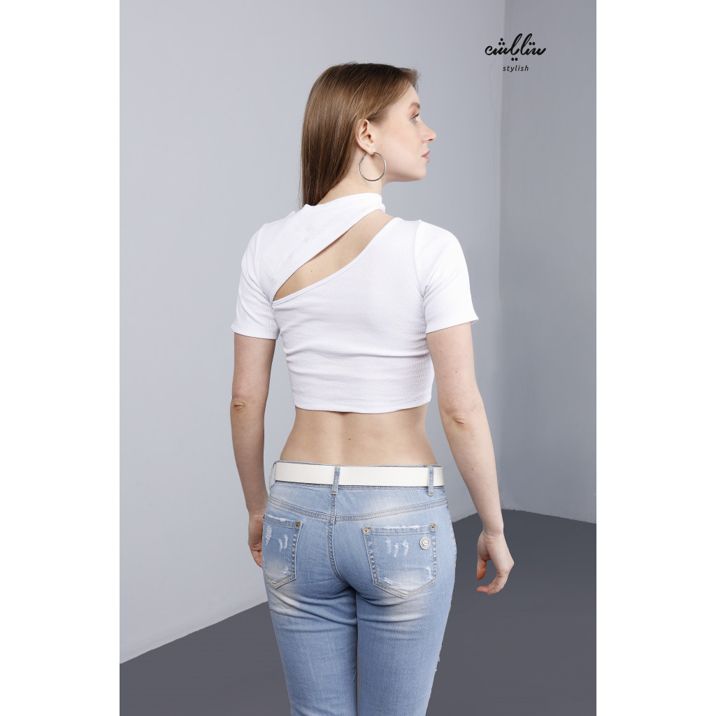 Soft white top with short waist and innovative neckline.