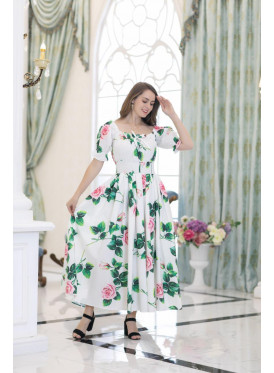 A long soft white dress decorated with floral prints