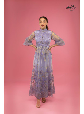 A sophisticated purple dress, embroidered with a high neckline
