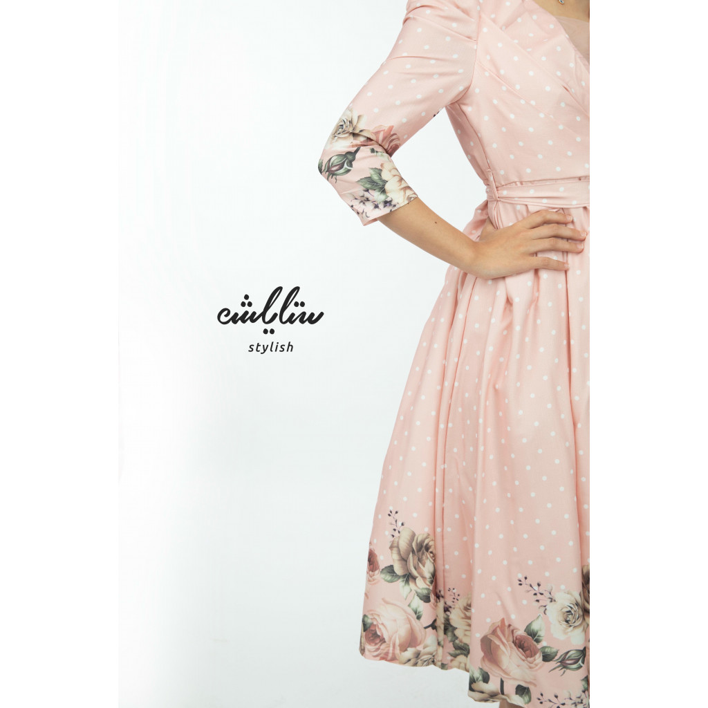A soft,  midi dress decorated with floral printed hem