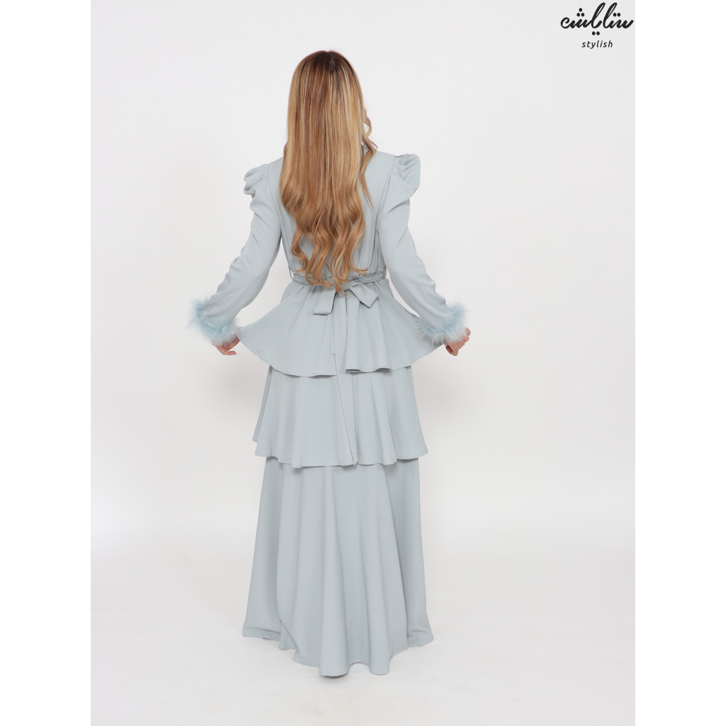classy cyan layered dress with feathers on the sleeves