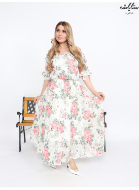 Long dress in off-white color. Decorated with ties on the sleeves