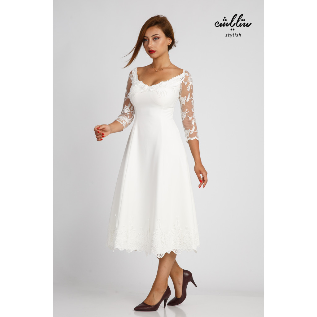 Elegant white midi dress with distinctive design and lace sleeves