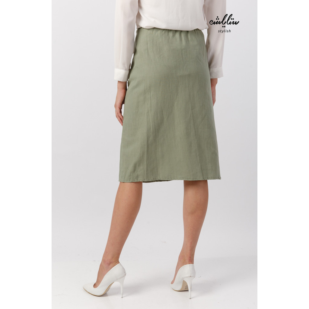 Elegant oily midi skirt decorated with buttons for a beautiful look