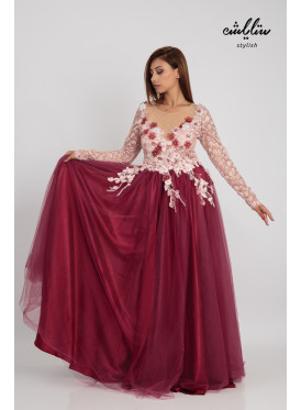 A luxurious dress that combines sophistication and elegance suitable for burgundy evenings decorated with prominent flowers and a touch of innovative lace embroidery and layers of satin and elegant tll