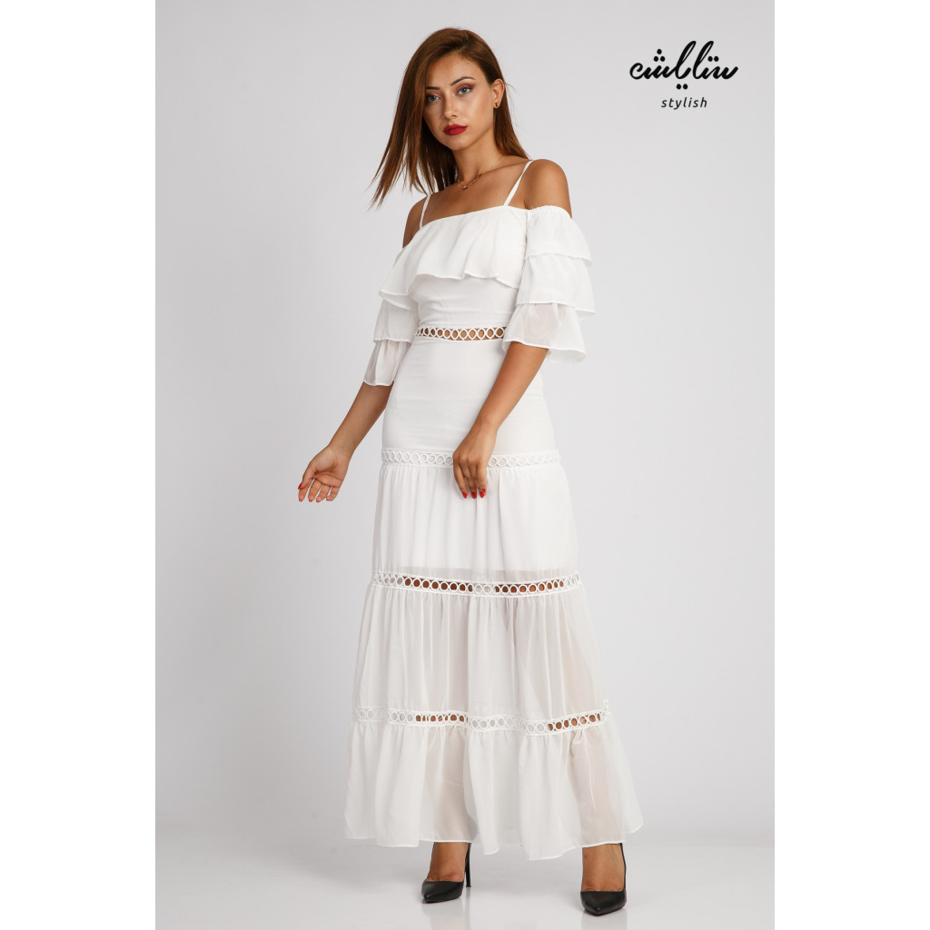 A long, soft white dress with layered sleeves for an attractive look