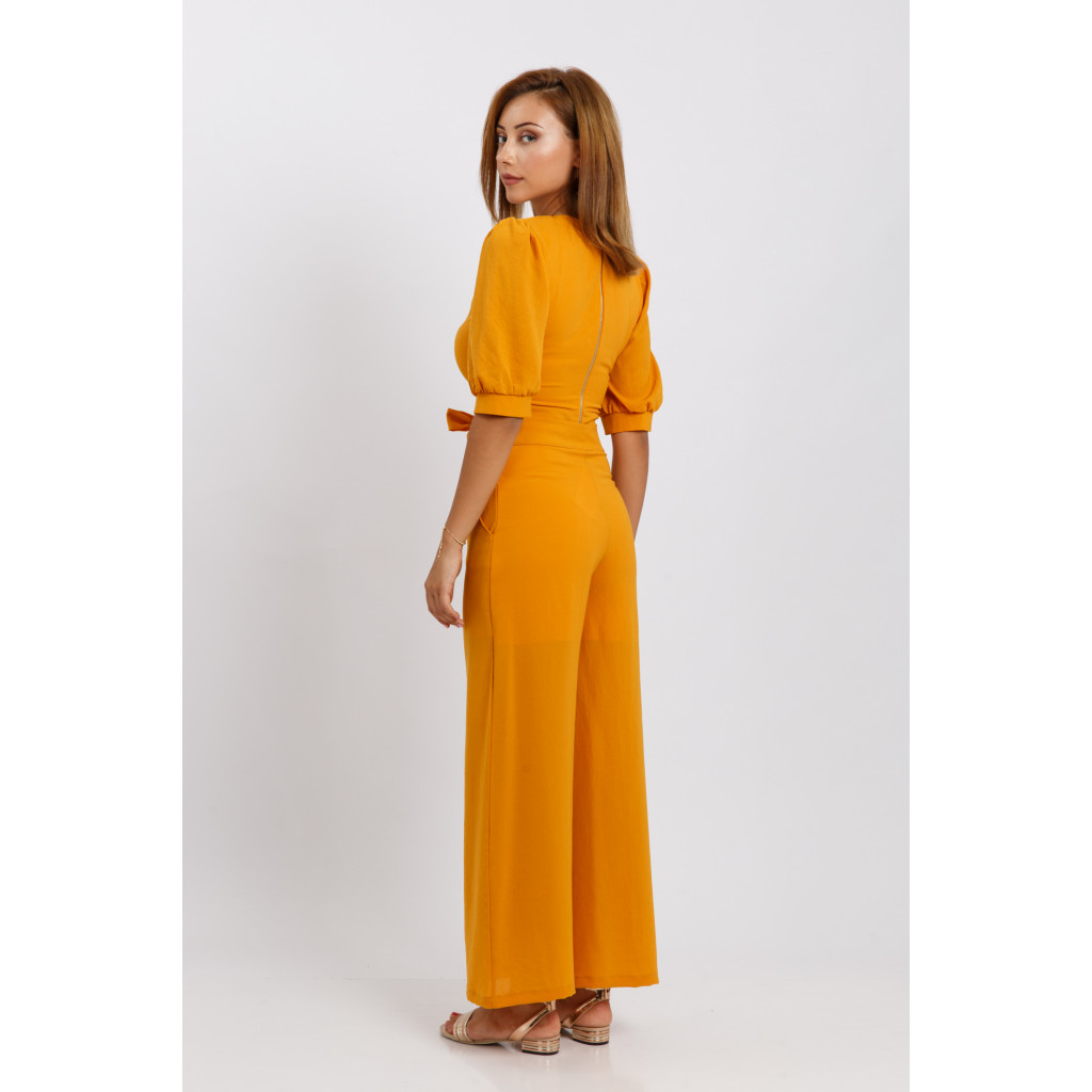 A beautiful mango-colored set ensemble with a stylish belt and high west pants decorated with side buttons for an attractive and striking look