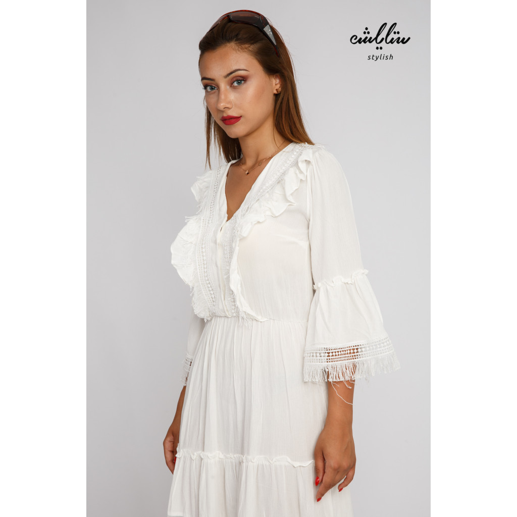 A long white dress with a very elegant lace
