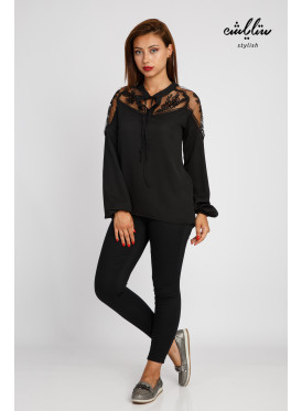Elegant black blouse with long sleeves and transparent shoulders decorated with lace, soft and attractive