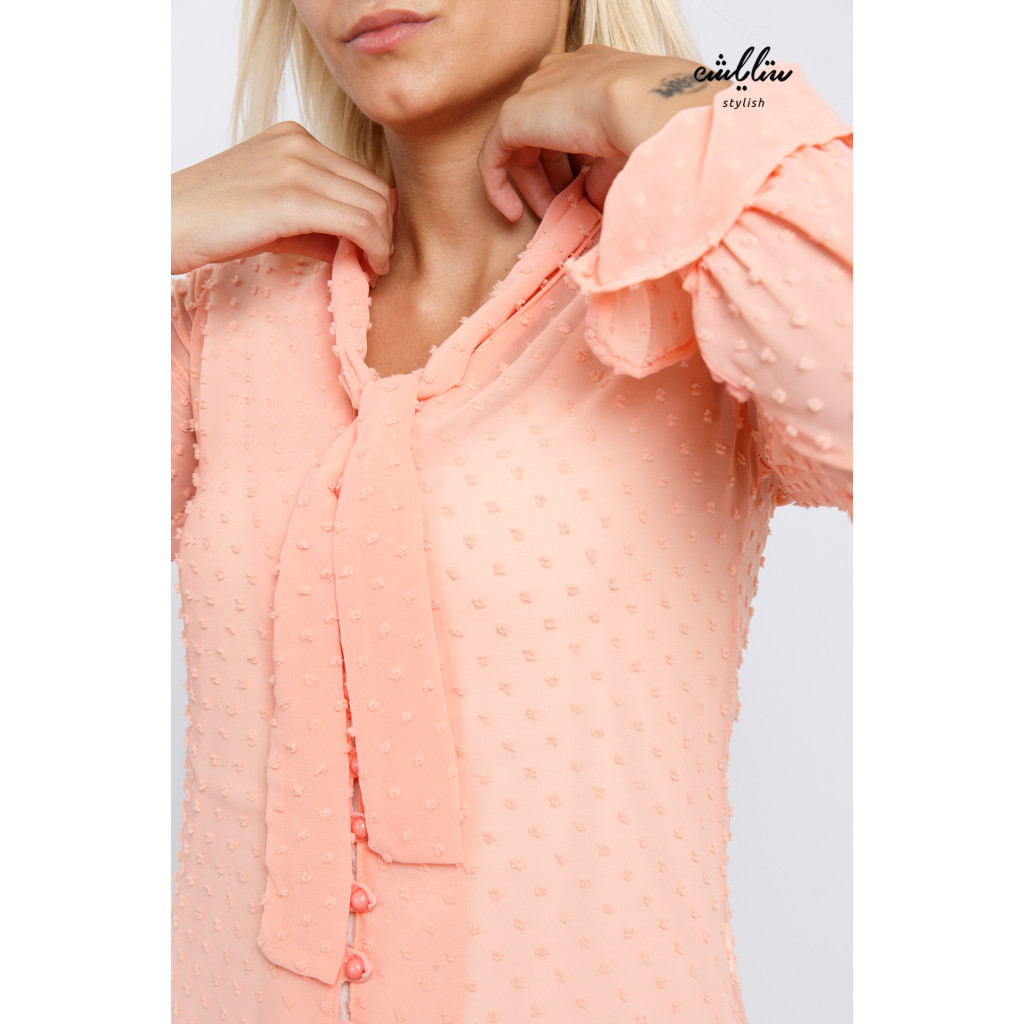 Elegant pink blouse with a tie for a tinge