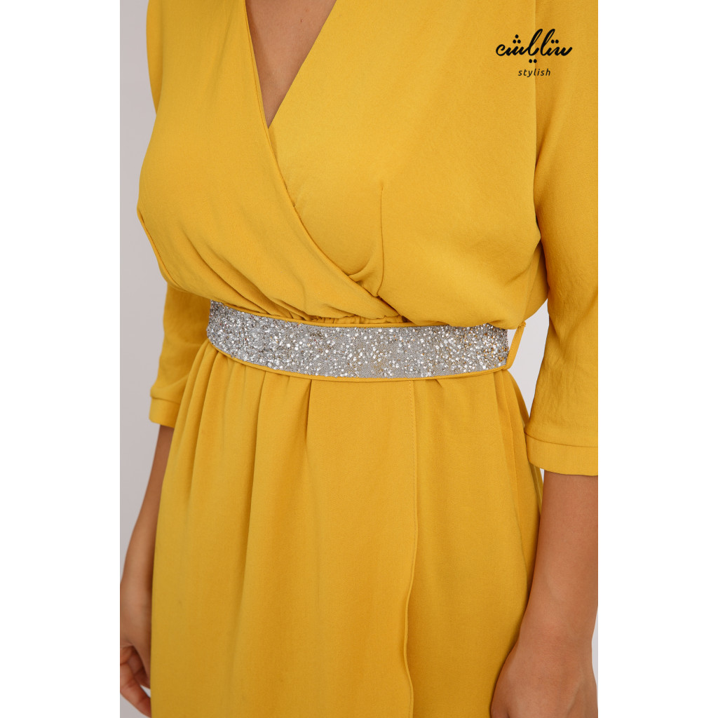 Stylish midi dress with a crystal belt with a chic in yellow cut