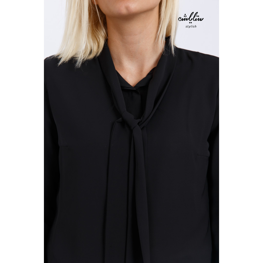 Soft black blouse with tie and long sleeves adds a chic touch