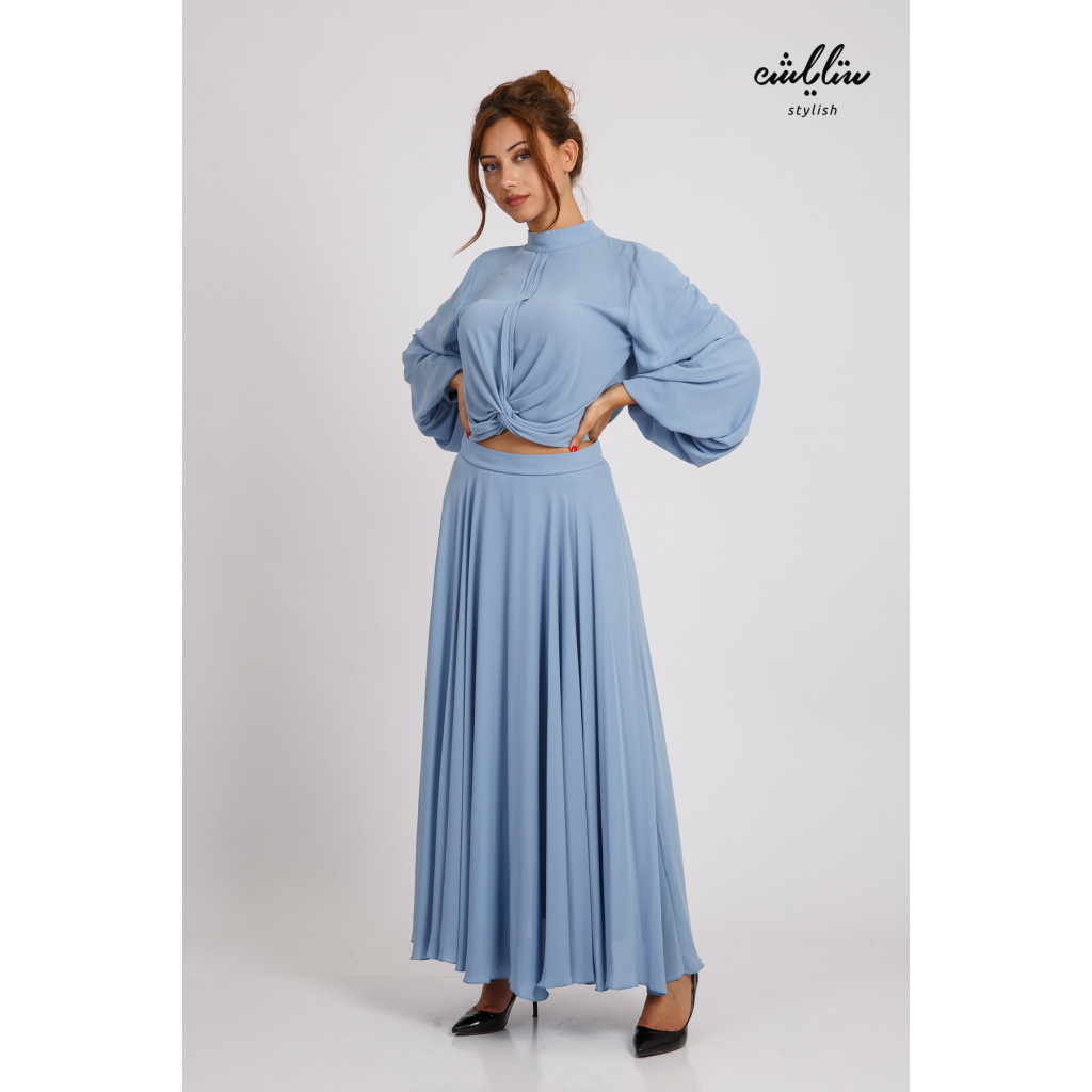 A luxurious taweer with a shimmering sky color with a high collar and long sleeves featuring the elegance of delicate folds suitable for evenings and occasions