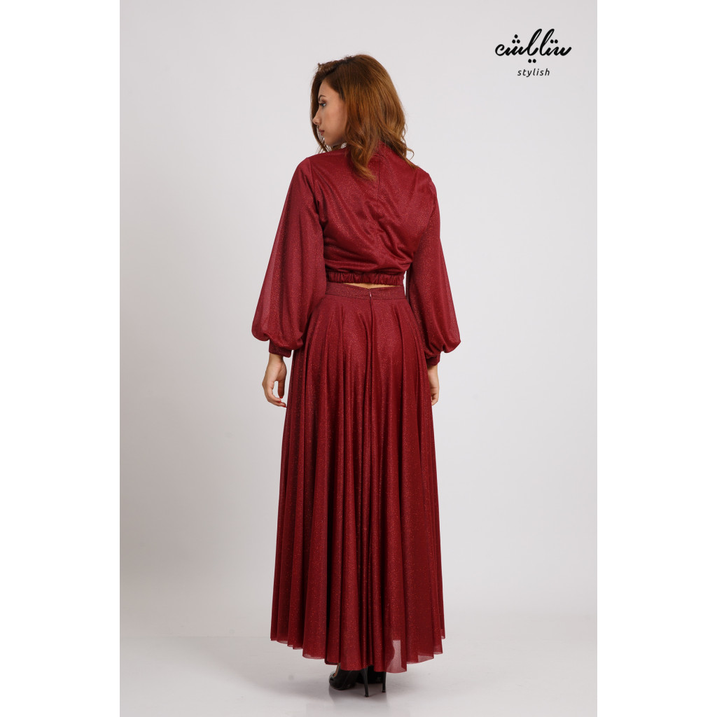 A luxurious dress with a burgundy glamour with a high collar and long sleeves featuring delicate folds suitable for evenings and events