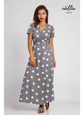 A soft and elegant grey maxi dress with a wrap-and-dotted pattern with a strap on the waist