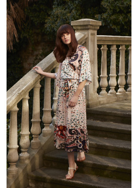 A very elegant midi dress with a wide twist in harmonious colors and a soft crisp charming texture