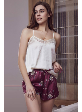 Elegant set of two pieces with white top, embellished with a touch of lace and a luxurious satin shorts