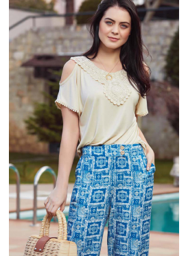 Stylish set with beige top and blue trousers in soft crisp attractive and striking tones