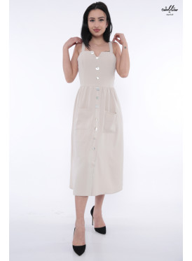 A very elegant midi dress in beige decorated with crisp luscious buttons