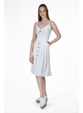 A very elegant midi dress in white decorated with buttons and a luscious crisp