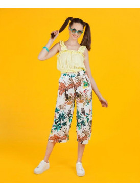 White midi pants with bright, colourful summer tree prints