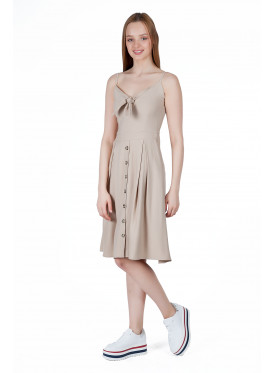 Very elegant midi dress in beige decorated with buttons and a luscious crisp