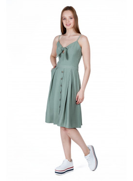 A very elegant midi dress in a dark Tevani decorated with buttons and a luscious crisp