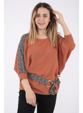 Elegant look for a brown blouse with lace and leopard skin design prints wide to add an appealing touch