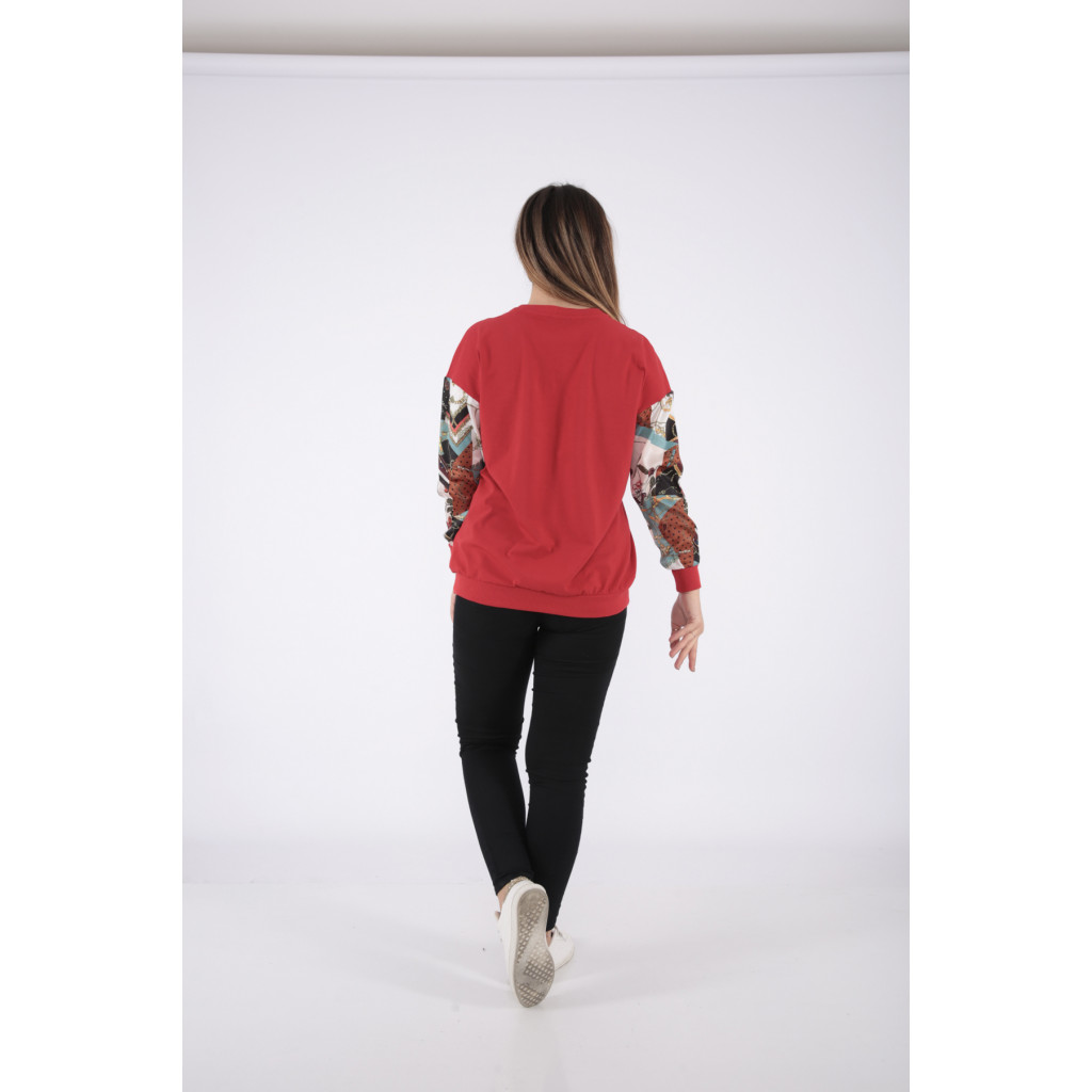 Red long sleeve blouse with high collar to give a modern touch