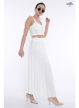 Long white beige skirt decorated with crumb with fine material and elegant view