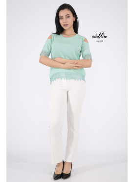 Soft light green blouse with shoulder holes decorated with lace edges