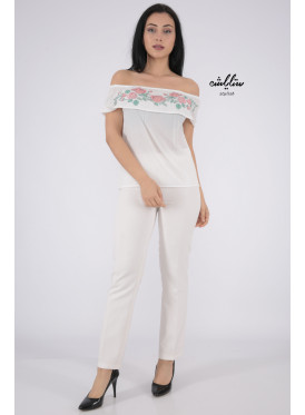 Elegant white blouse with sleeves of schulder exposed and engraved around the chest