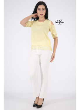 A soft yellow blouse with lace edges decorated