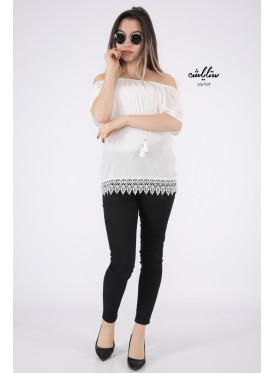 Elegant white blouse with bare shoulders decorated with lace